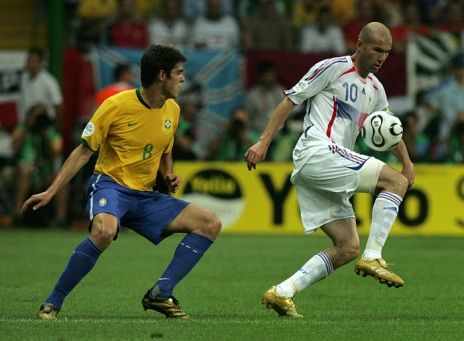 Zidane (right) whizzing past Brazilian defender