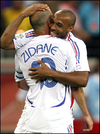 France's Zidane & Thierry embrace