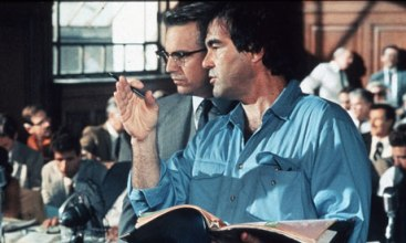 Oliver Stone conferring with Costner