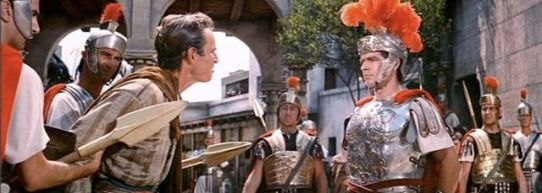 Judah is arrested by Messala (Stephen Boyd)