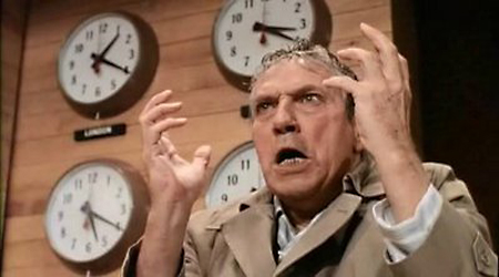 Peter Finch as Howard Beale in Network