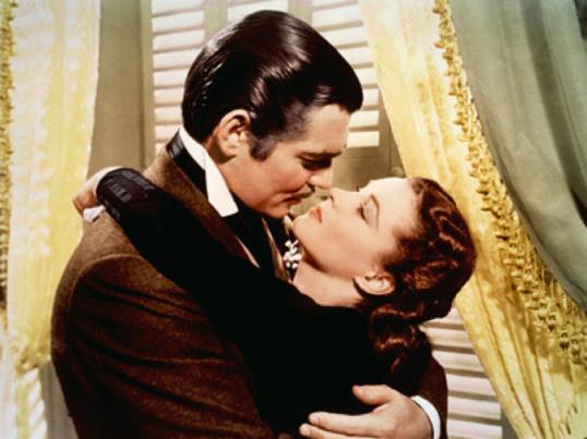 Rhett Butler (Clark Gable) kisses Scarlett O'Hara (Vivien Leigh)