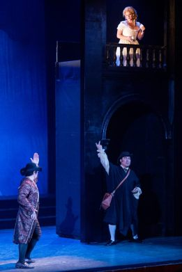 The balcony scene: Leporello (Adam Lau) pretends to woo Donna Elvira (Hailey Clark) as the Don (Jeongcheol Cha) coaches him