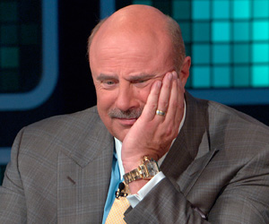 Dr. Phil listening to Randy, Paula, Clay, William and Kelly