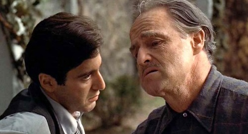 Michael (Al Pacino) listens to his father (Marlon Brando)