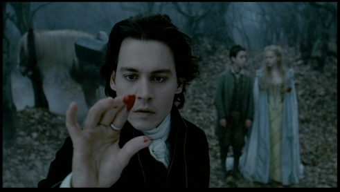 Bloody fingertip: Depp with Marc Pickering & Christina Ricci in background