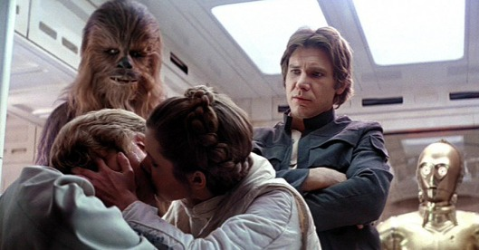 Leia kisses Luke, while Han & Chewie look on