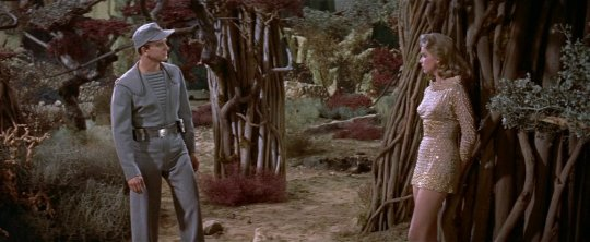 Adams (Leslie Nielsen) berates Alta for wearing a miniskirt