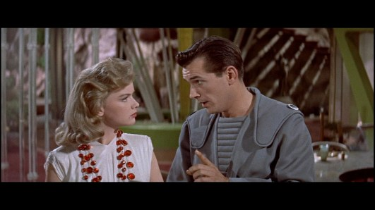 Alta (Anne Francis) being lectured to by Farman (Jack Kelly)