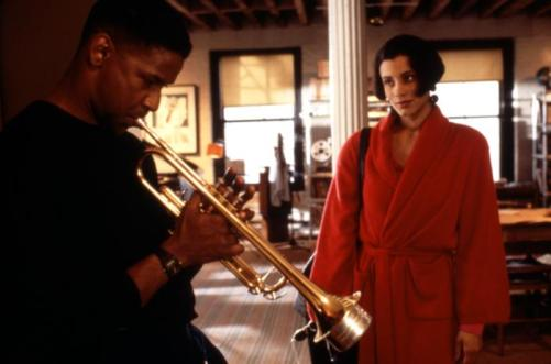 Bleek entertains Clarke (Cynda Williams) in his apartment
