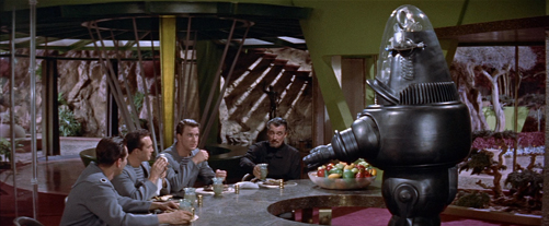 Robby the Robot serving Morbius (center) and the officers of C-57D
