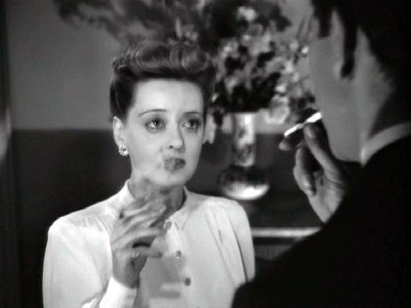 Charlotte & Jerry share a smoke together in the iconic final scene of Now, Voyager