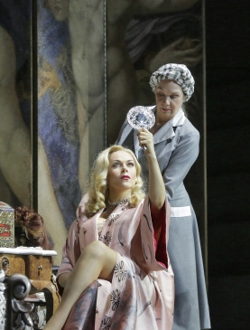 Kristine Opolais as Manon Lescaut attending to her makeup, in Act II (Photo: Ken Howard)