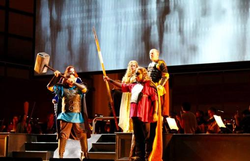 Donner (Adam Lau) swings that might hammer, as Wotan (Alfred Walker) puts a stop to his antics (Photo: North Carolina Opera)