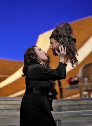 Salome (Patricia Racette) holding aloft the head of John the Baptist, or Jokanaan, in Strauss' Salome at the Met (Photo: Ken Howard)